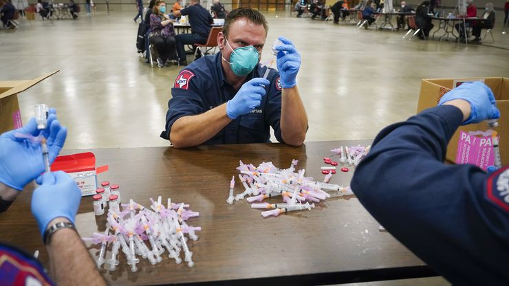 Arlington Fire Department captain K.J. Land  prepares doses of the Moderna COVID-19 vaccine at the Esports Stadium Arlington & Expo Center on Tuesday, Jan. 5, 2021, in Arlington. The Tarrant County Public Health (TCHP) vaccination program is being implemented by the Arlington Fire Department as part of the city's mass vaccination effort.