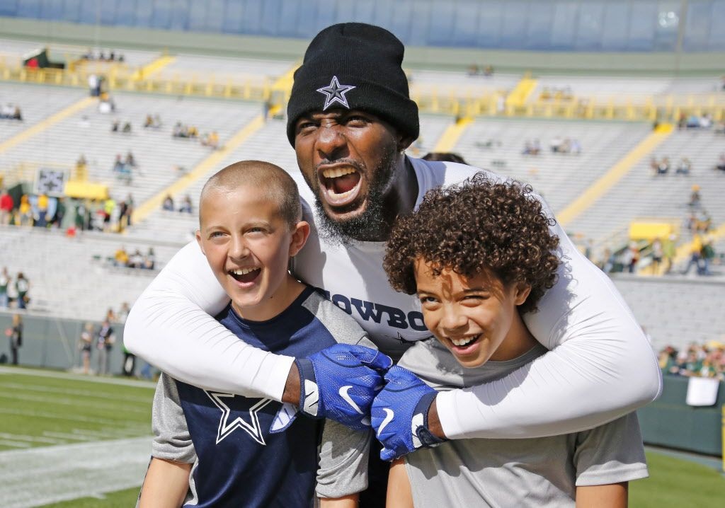 Dallas Cowboys wide receiver Dez Bryant (88) poses for a photo with youngsters Brock O'Quinn, left, and Gbe McClay, right, before the Dallas Cowboys vs. the Green Bay Packers NFL football game at Lambeau Field in Green Bay, Wisconsin, on Sunday, October 16, 2016. (Louis DeLuca/The Dallas Morning News)