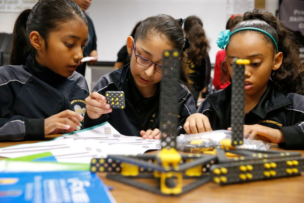 Leah Ybarra, 9, Ibri Cotonieto, 9, and Alexi Greenwood work on next years robot project during robotics club at Winnetka Elementary in Dallas on May 26, 2017.