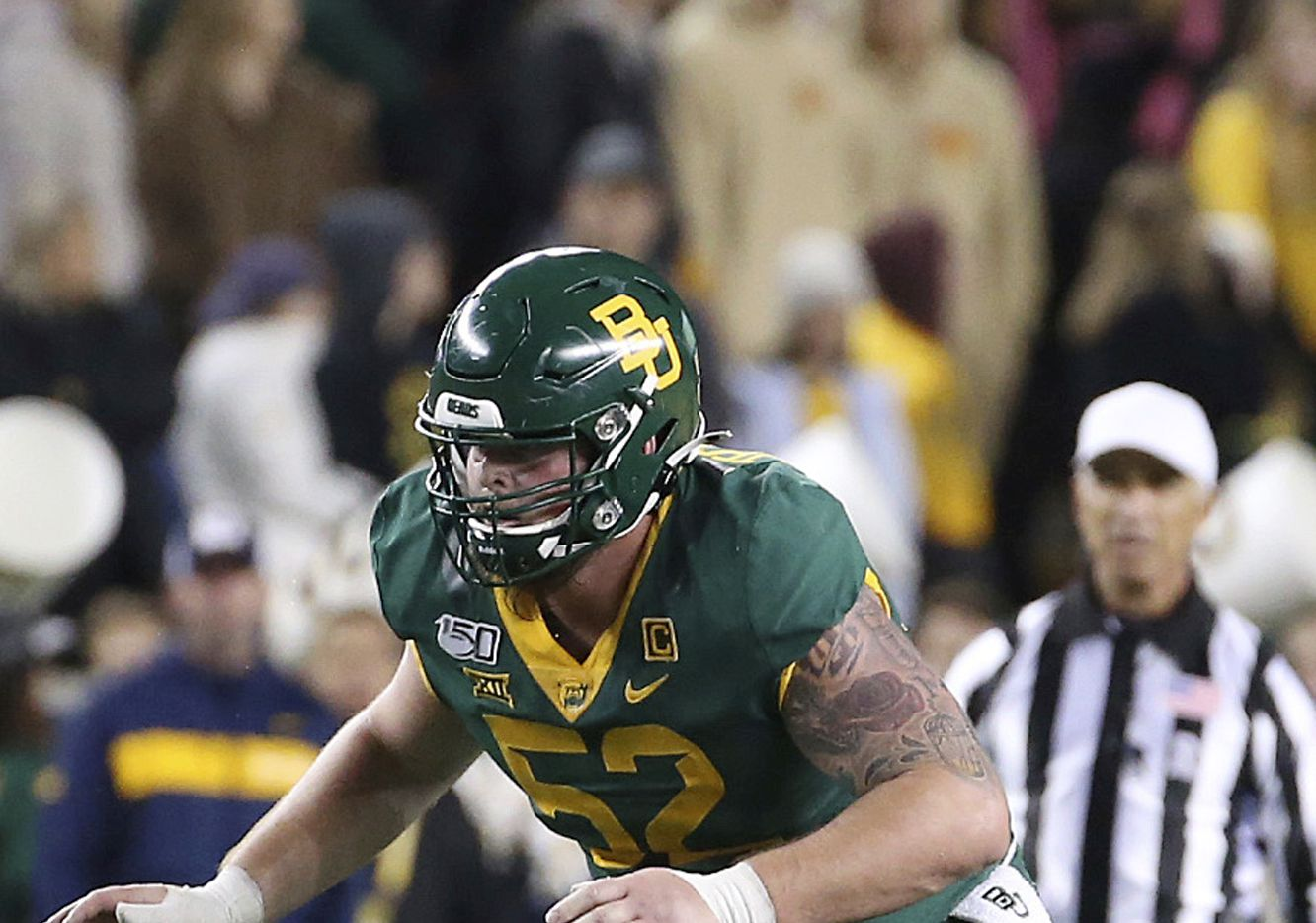 FILE - In this Oct. 31, 2019, file photo, Baylor offensive lineman Sam Tecklenburg (52) blocks during an NCAA college football game against West Virginia in Waco, Texas. Tecklenburg was selected to The Associated Press All-Big 12 Conference team, Friday, Dec. 13, 2019.