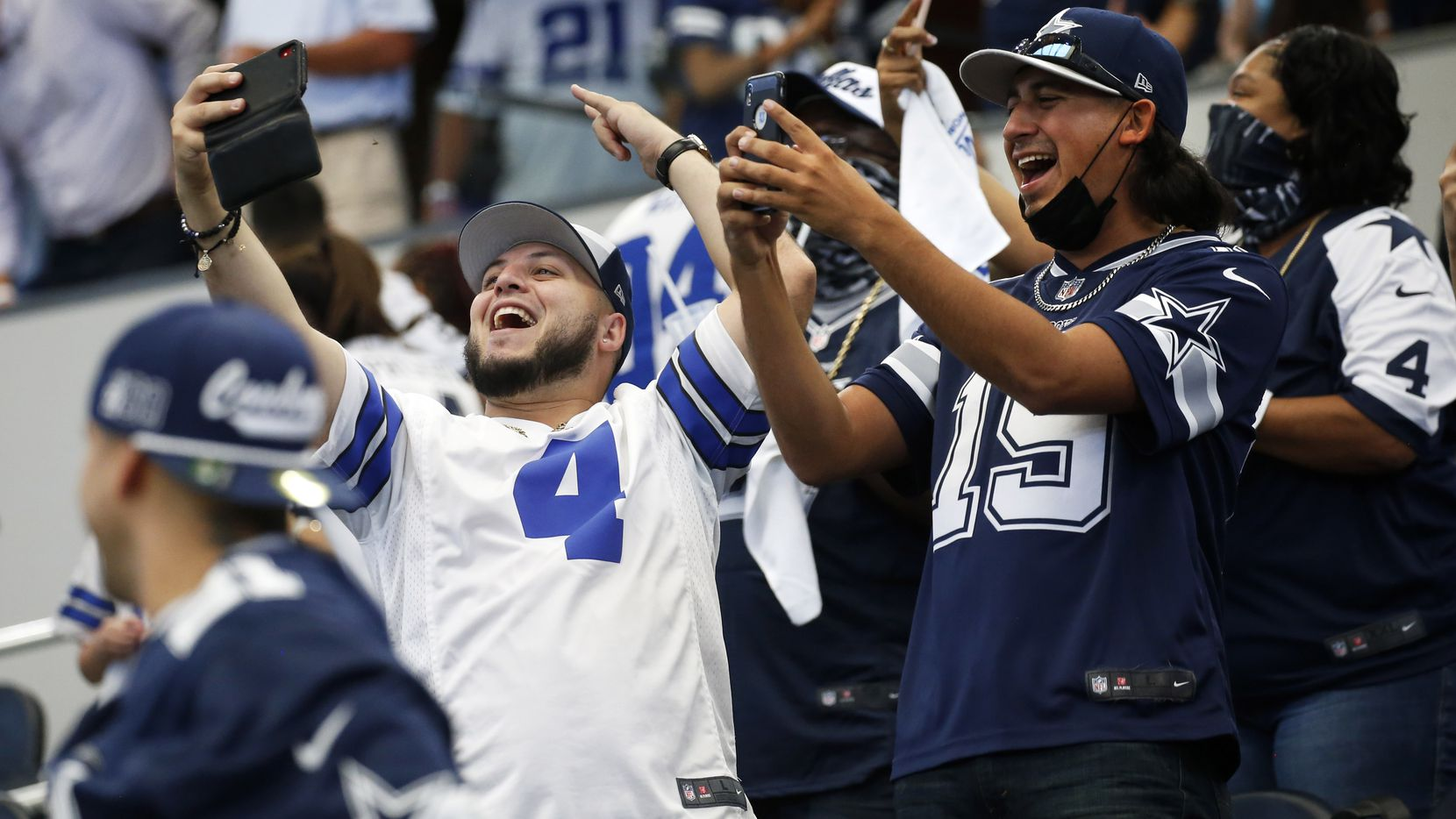 Cowboys fans celebrate after Cowboys kicker Greg Zuerlein (2) kicks the winning field goal in the final seconds of a game against the Falcons at AT&T Stadium in Arlington on Sunday, Sept. 20, 2020.