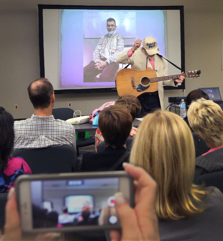 Jeffrey Weiss touchingly sings for co-workers a song he wrote at his career tribute party at The Dallas Morning News on Wednesday, March 1, 2017. (Louis DeLuca/The Dallas Morning News)