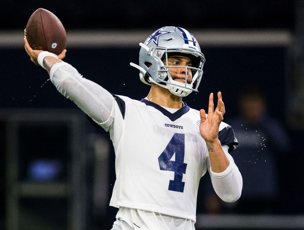 Dallas Cowboys quarterback Dak Prescott (4) throws a pass during a Dallas Cowboys OTA practice on Wednesday, May 22, 2019 at The Star in Frisco. (Ashley Landis/The Dallas Morning News)