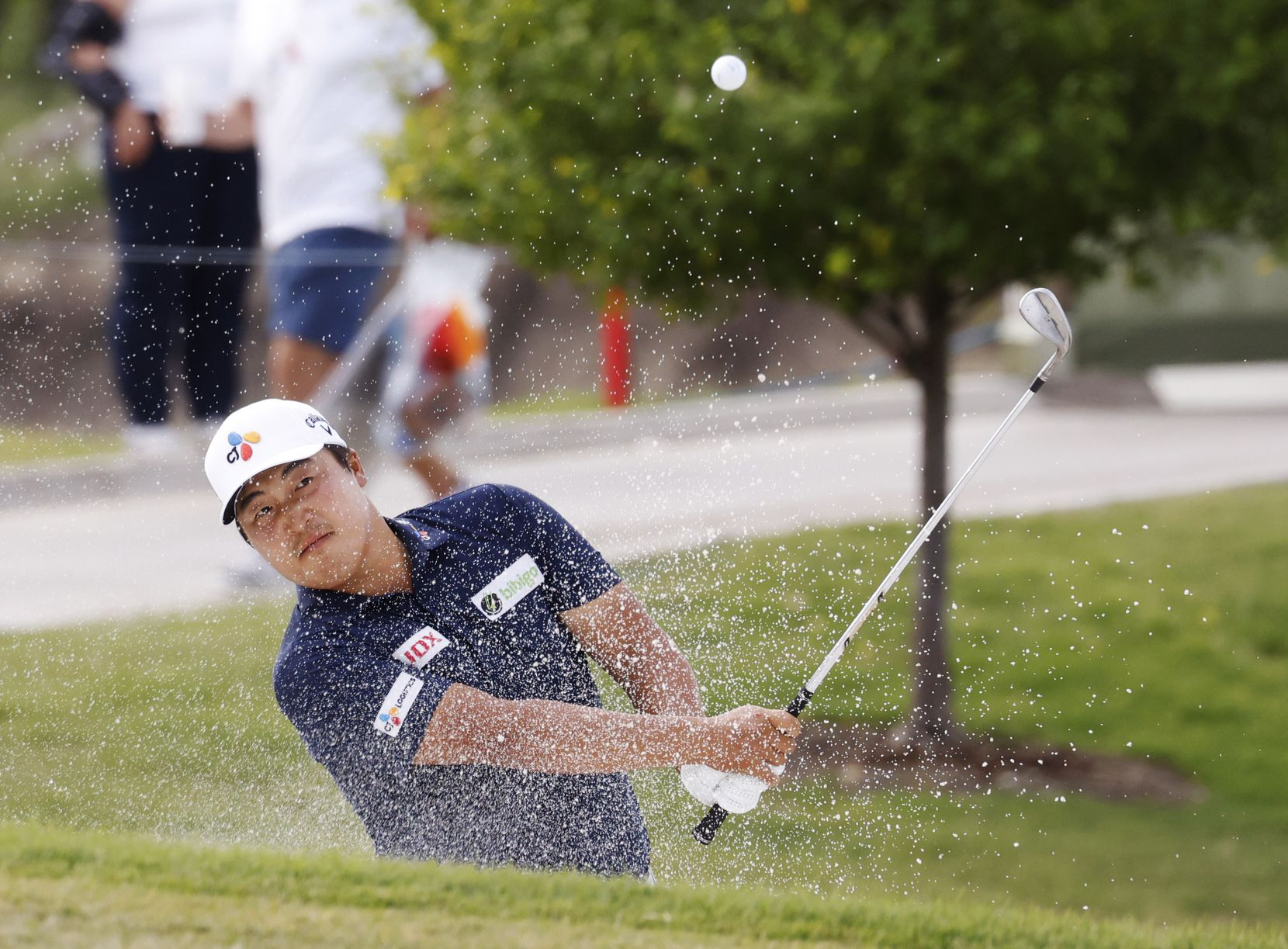Kyoung-Hoon Lee hits out of a bunker on the 18th hole during round 3 of the AT&T Byron Nelson  at TPC Craig Ranch on Saturday, May 15, 2021 in McKinney, Texas. (Vernon Bryant/The Dallas Morning News)