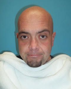 Tony Lee Debolt, 39, was arrested Monday night on multiple charges related to drug and firearm possession as well as forgery.
