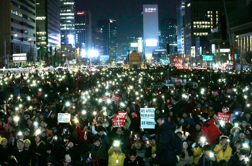 Protesters held up their smartphone lights during a rally calling for impeached President Park Geun-hye's arrest in Seoul, South Korea, in March. (Ahn Young-joon/The Associated Press)