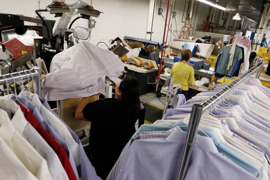 Candy Rodriguez (left) and Maria Mendoza press shirts at Sunshine Laundry and  Dry Cleaners in Dallas. The company was started in 1941. (David Woo/The Dallas Morning News)