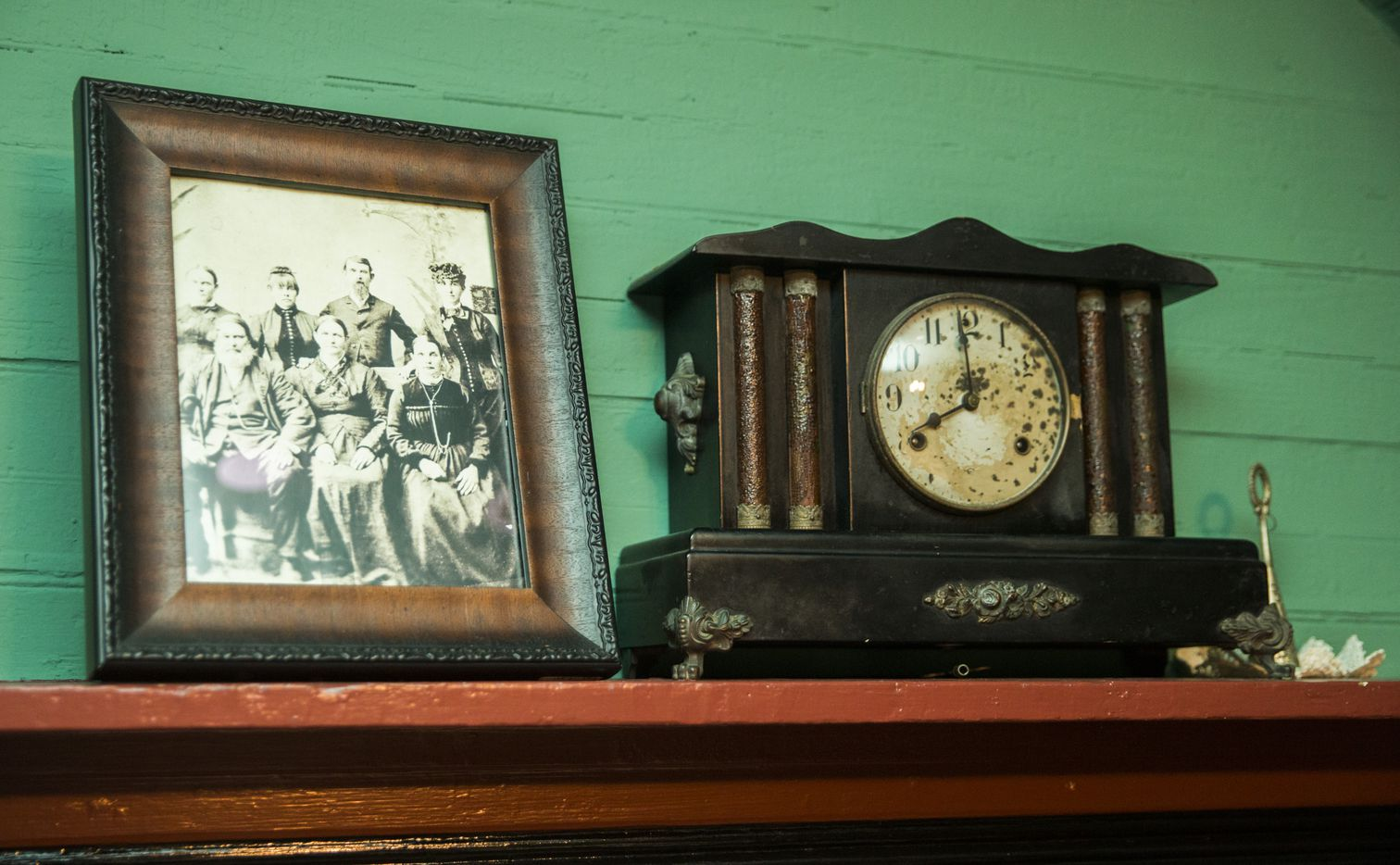 A portrait of the Lawrence family is displayed on the dining room mantle inside the oldest part of the home.