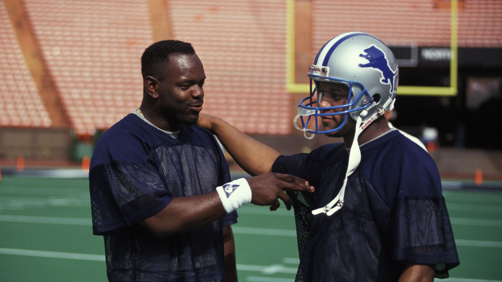 FILE — Barry Sanders and Emmitt Smith talk before Pro Bowl practice at the 1994 Pro Bowl at Aloha Stadium.