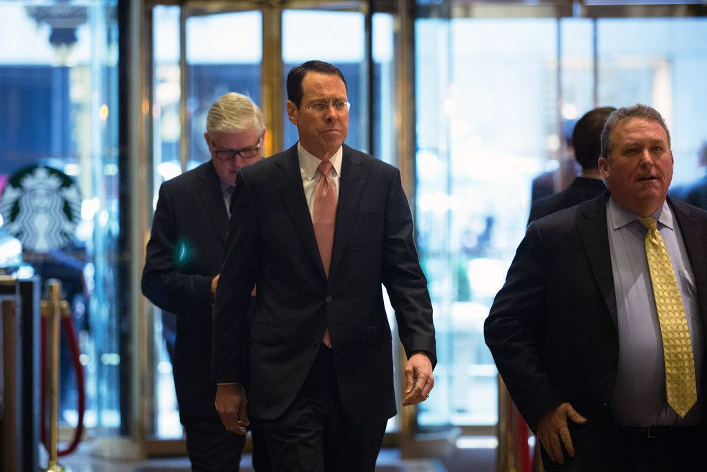 AT&T CEO Randall Stephenson (left) went to Trump Tower in New York for a meeting with the president on Jan. 12, 2017. He was accompanied by Bob Quinn (right), who will retire after the revelation that the Dallas-based telecom paid Trump's personal attorney Michael Cohen. (Kevin Hagen/The New York Times)