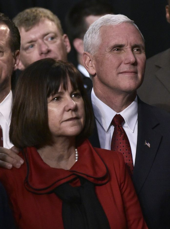 Republican Vice presidential nominee Mike Pence and wife Karen watch as Republican presidential nominee Donald Trump addresses the final rally of his 2016 presidential campaign at Devos Place in Grand Rapids, Michigan on November 7, 2016. / AFP PHOTO / MANDEL NGANMANDEL NGAN/AFP/Getty Images