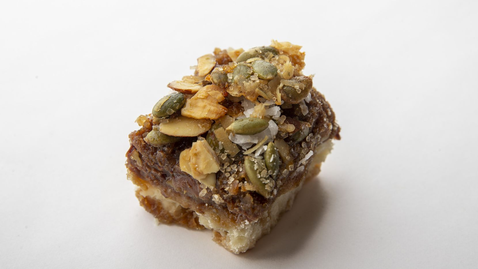 The Buena Onda spicy almond-pepita and pilloncillo cluster bars made by Rex Poland won the bar category at the 24th annual Holiday Cookie Contest hosted by The Dallas Morning News.