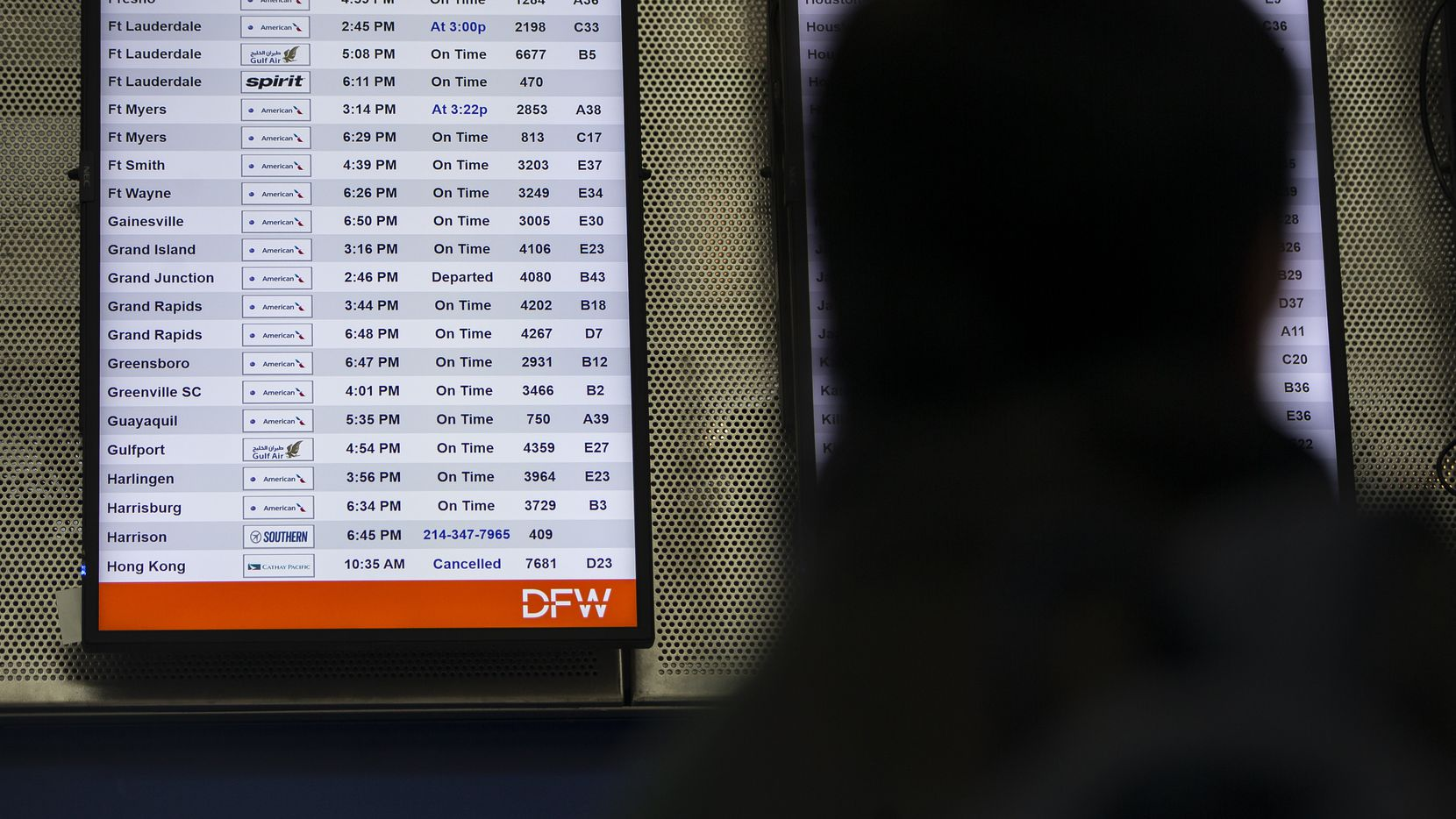 A cancelled flight departing to Hong Kong is shown on the board in Terminal D at DFW International Airport on Jan. 31, 2020. American Airlines is canceling all flights to mainland China as of Friday, but will keep flights to Hong Kong. (Juan Figueroa/ The Dallas Morning News