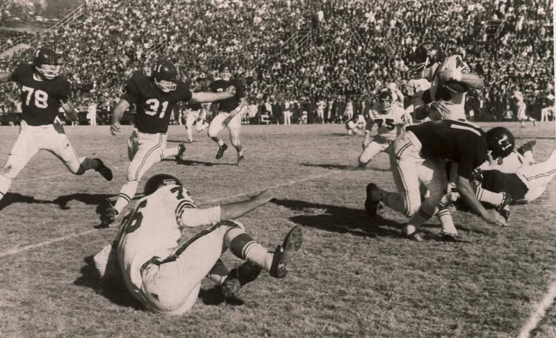 Jerry Jones (No.31) known for energy and determination, heads for the action as football player for thr Arkansas Razorbacks. Jones was a leader on the Arkansas team that was declared the national champion after winning the 1965 Cotton Bowl.