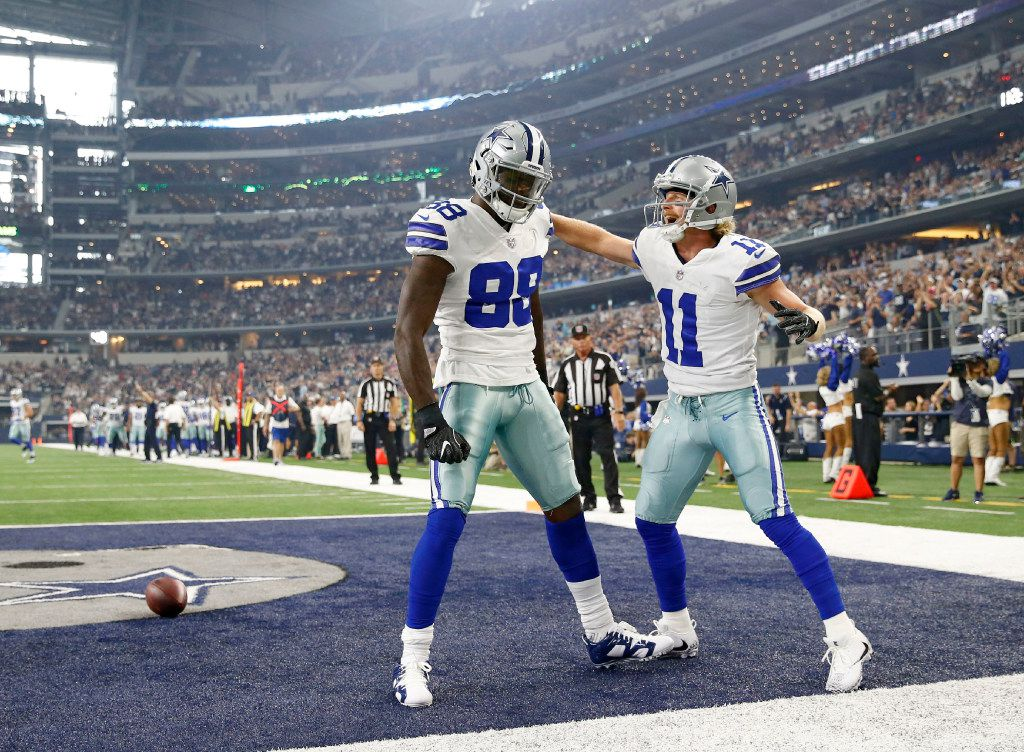 Dallas Cowboys wide receiver Dez Bryant (88) celebrates with Dallas Cowboys wide receiver Cole Beasley (11) after scoring a touchdown on the opening drive against the Indianapolis Colts during the first half of a preseason game at AT&T Stadium in Arlington on Saturday, August 19, 2017. (Vernon Bryant/The Dallas Morning News)