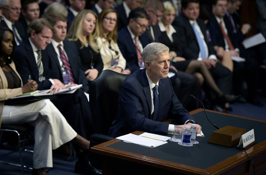Neil Gorsuch listens during the Senate Judiciary Committee confirmation hearing as US President Donald Trump's nominee for the Supreme Court on Capitol Hill in Washington,DC on March 20, 2017. / AFP PHOTO / Brendan Smialowski/AFP/Getty Images