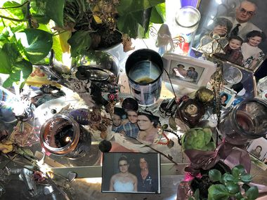 A table of remembrances sits near a window in the home of Kati Wall, who lost her parents Dennis and Sara Johnson in the Sutherland Springs church shooting. She and her family are packing to move away from the scene of the tragedy.