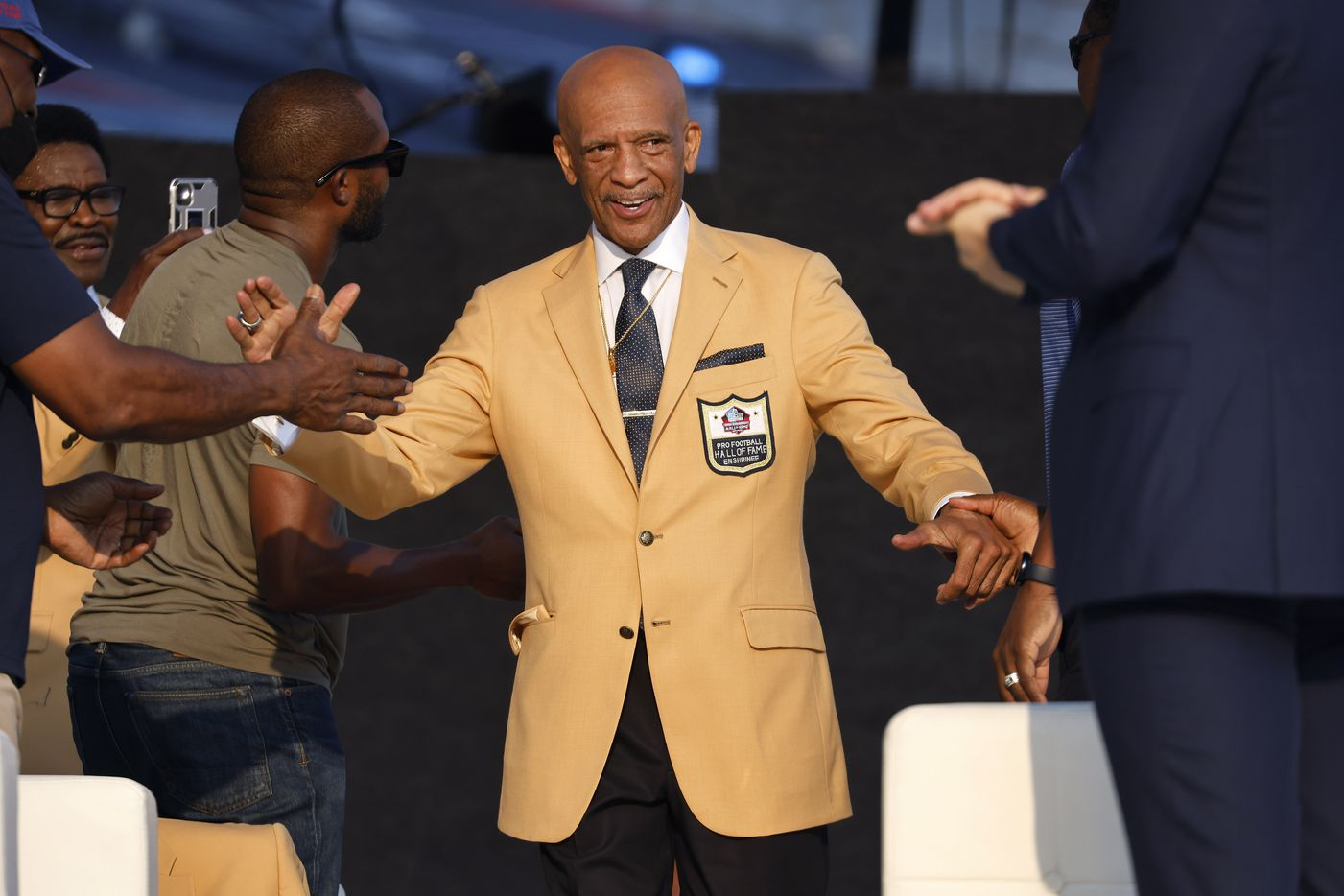 Pro Football Hall of Fame inductee Drew Pearson of the Dallas Cowboys is introduced and congratulated by fellow members during the Class of 2021 enshrinement ceremony at Tom Benson Hall of Fame Stadium in Canton, Ohio, Sunday, August 8, 2021. (Tom Fox/The Dallas Morning News)