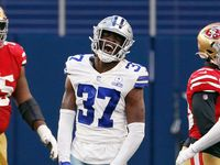 Cowboys safety Donovan Wilson (37) celebrates after intercepting a pass during the fourth quarter of a game against the 49ers at AT&T Stadium on Sunday, Dec. 20, 2020, in Arlington.