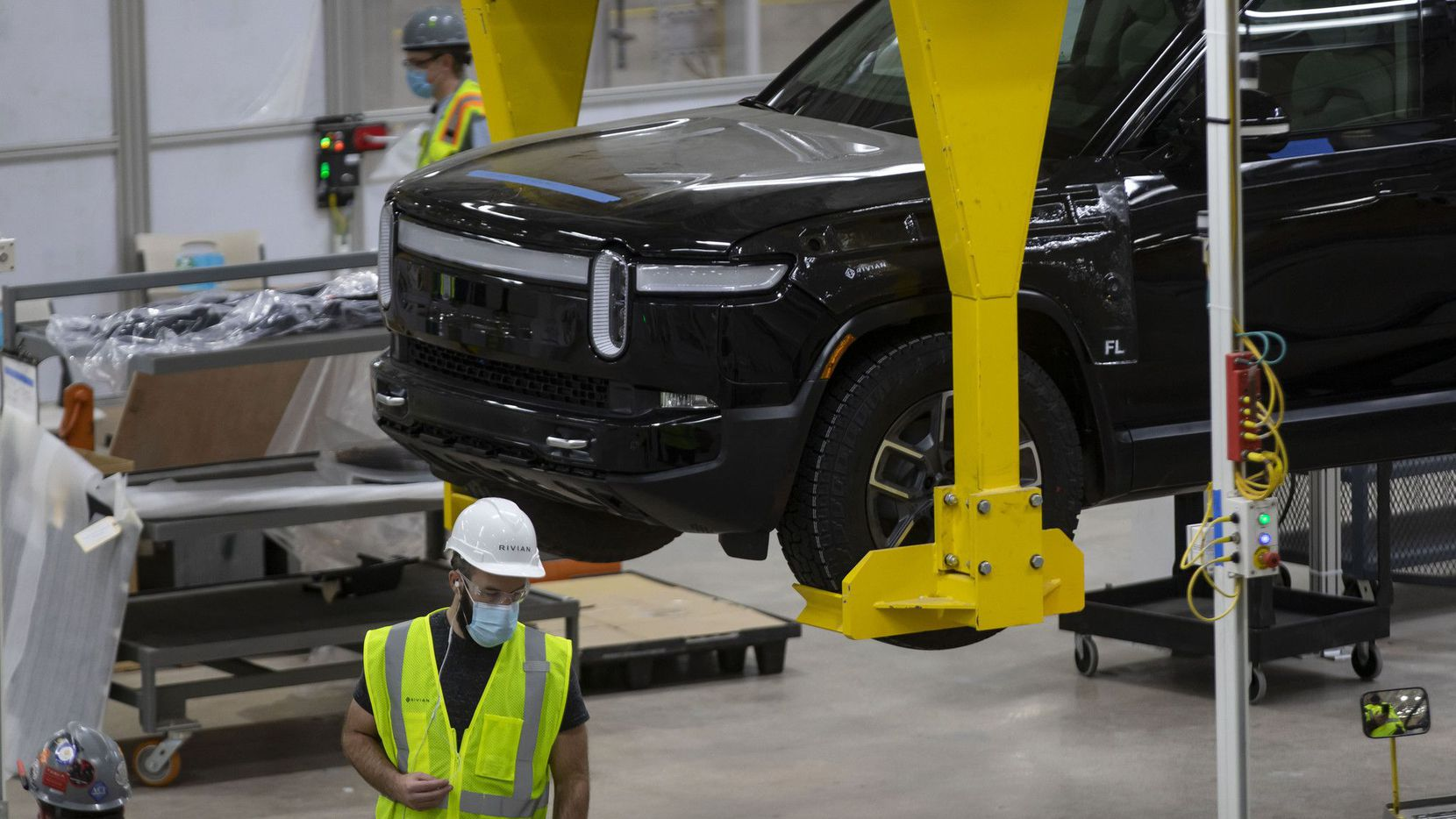 Vehicles are assembled and tested April 14, 2021, at the Rivian plant in Normal, Ill.