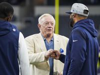 Dallas Cowboys owner and general manager Jerry Jones fist bumps quarterback Dak Prescott as he chats with wide receiver Amari Cooper while players warm before a preseason NFL football game at AT&T Stadium on Sunday, Aug. 29, 2021, in Arlington.