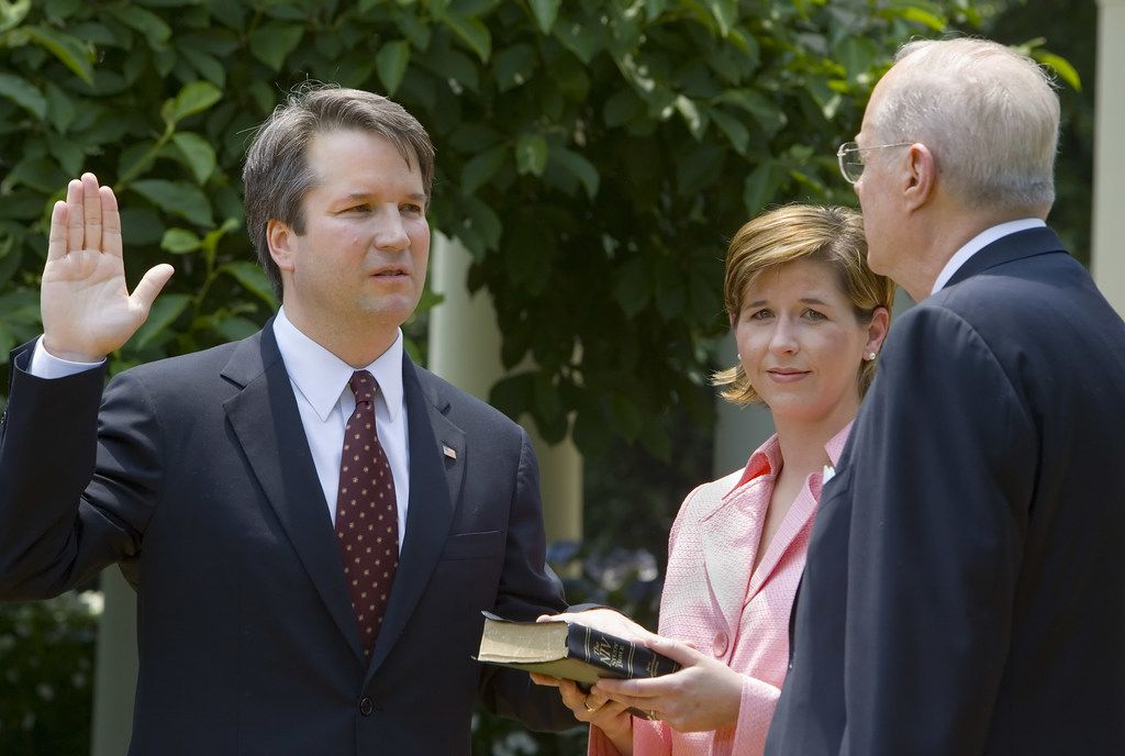Brett Kavanaugh is sworn in as a Court of Appeals Judge for the District of Columbia by Justice Anthony Kennedy, as Kavanaugh's wife Ashley holds the Bible during the Rose Garden ceremony on June 1, 2006.