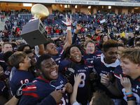 Denton Ryan High School Ja'tavion Sanders (1) holds up the semi-finals championship trophy with his team after winning 35-7 as Frisco Lone Star High School played Denton Ryan High School in a Class 5A Division I state semifinal game at Eagle Stadium in Allen on Saturday, December 14, 2019. (Stewart F. House/Special Contributor)