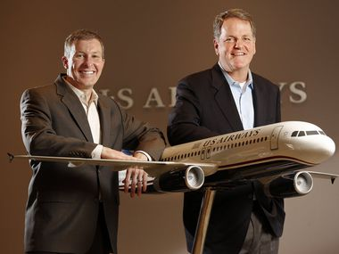 Scott Kirby (left) and Doug Parker became American Airlines' top executives after the 2013 merger with U.S. Airways. (File Photo)