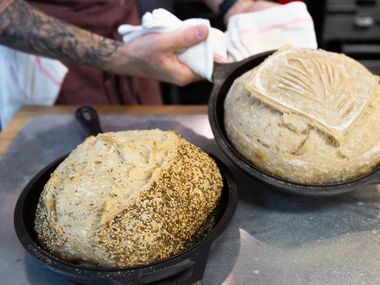 Matt Bresnan removes two loaves of bread in the Nonna kitchen in Highland Park in Dallas on July 1, 2019. Bresnan and his wife, Jenna, are opening a bakery in downtown McKinney this fall.