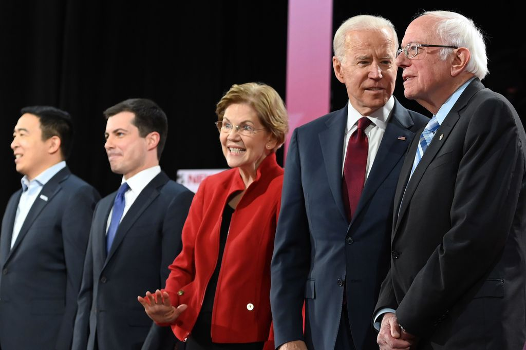 Democratic presidential hopefuls (from left): entrepreneur Andrew Yang; Mayor of South Bend, Ind., Pete Buttigieg; Massachusetts Sen. Elizabeth Warren; former Vice President Joe Biden; and Vermont Sen. Bernie Sanders, at a Democratic primary debate on Dec. 19. (Photo by Robyn Beck/AFP via Getty Images)
