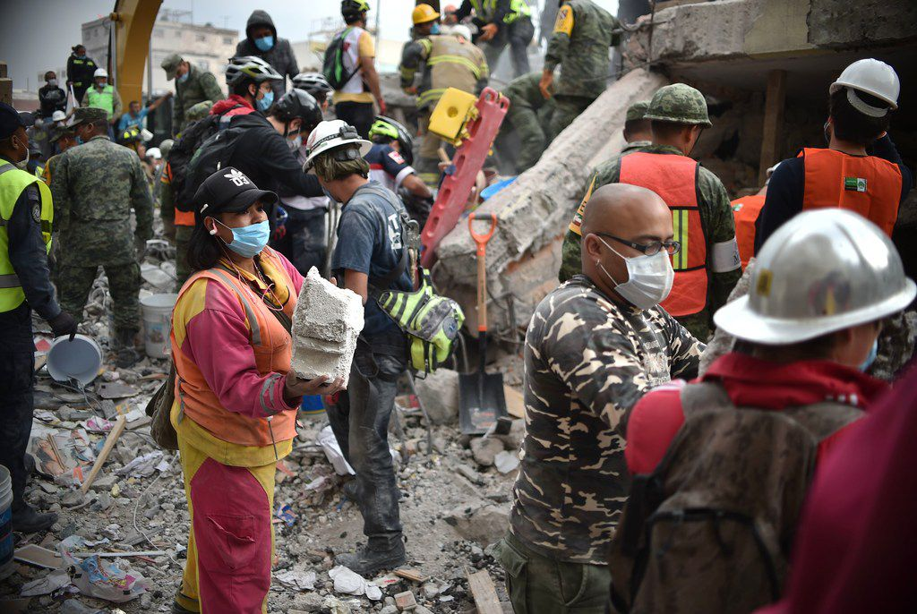Volunteers removed rubble during the search for survivors in a flattened building in Mexico City on Wednesday. (Yuri Cortez/Agence France-Presse)