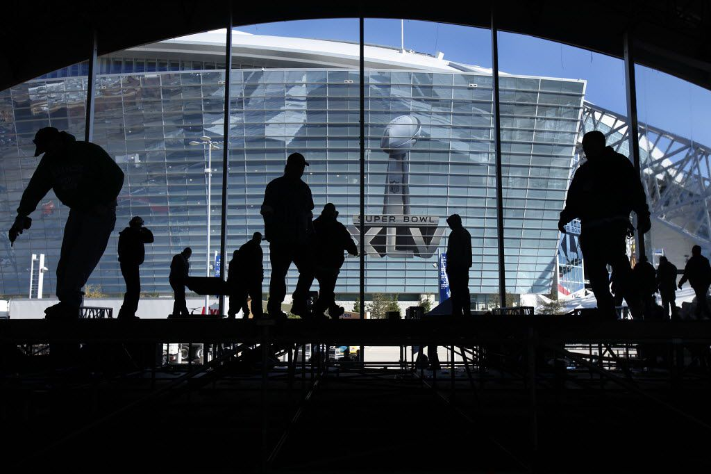 Workers disassemble the massive NFL Tailgate Party tent outside of Cowboys Stadium the day after Super Bowl XLV, Monday, February 7, 2011, in Arlington, Texas. Workers were deconstructing things used for putting on the Super Bowl. (Tom Fox/The Dallas Morning News)