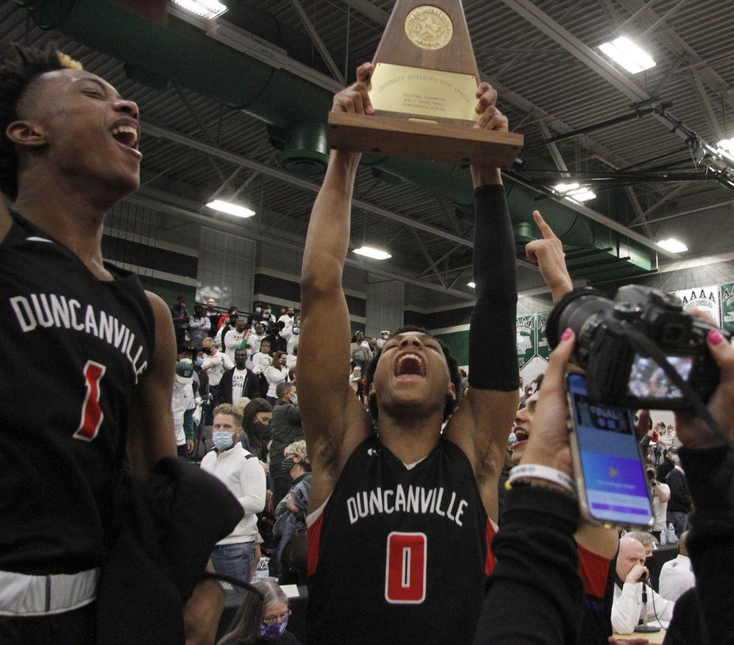 Duncanville's Ronald Holland (1) lets out a yell as does teammate Zhuric Phelps (0) after the Panthers were presented the regional trophy following their 70-65 victory over Waxahachie to advance. The two teams played their Class 6A Region ll boys final  playoff basketball game at Waxahachie High School in Waxahachie on March 5, 2021. (Steve Hamm/ Special Contributor)