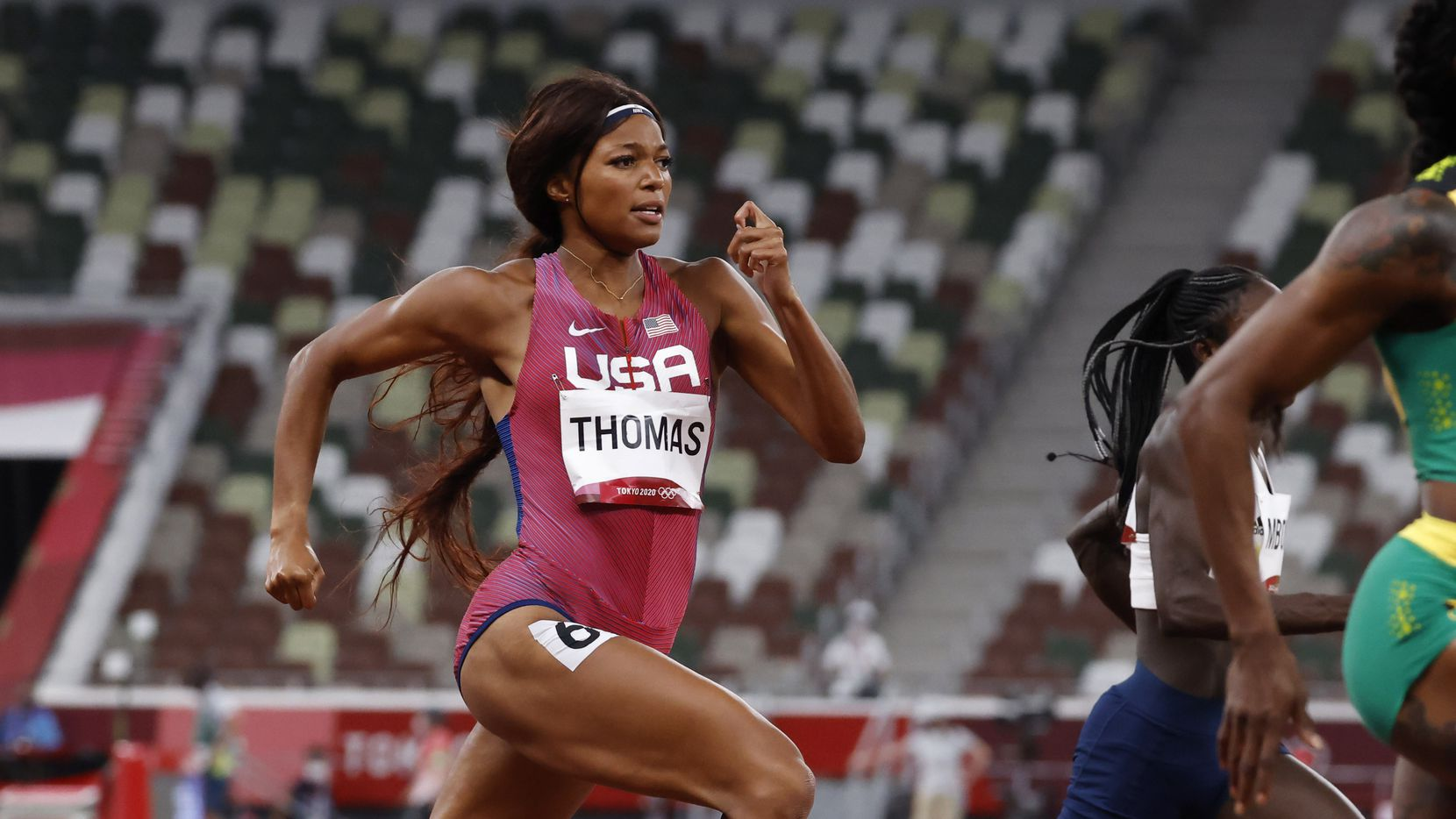 USA's Gabrielle Thomas competes in the women's 200 meter semifinal during the postponed 2020 Tokyo Olympics at Olympic Stadium, on Monday, August 2, 2021, in Tokyo, Japan. Thomas finished with a time of 22.01 seconds to advance to the final.