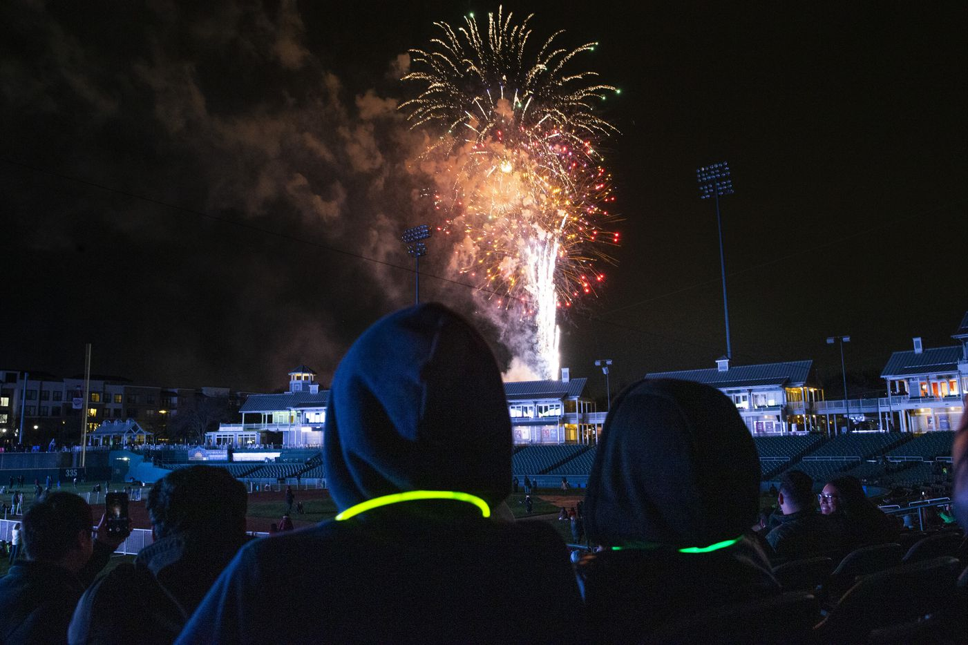 Attendees watch the Day 1 Dallas festival fireworks show at the Dr. Pepper Ballpark in Frisco, Texas, on Wednesday, Jan. 1, 2020. Day 1 Dallas is a kid-friendly New Year's Day festival that features rock-climbing, arts and crafts, bounce houses, and a fireworks show.