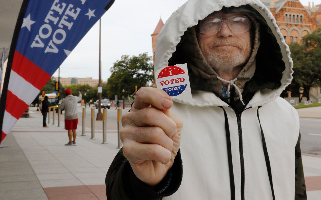 "Hollis Gerald Bintliff show his ""I VOTED Today"" sticker after voting early at the George L. Allen Sr. Courts Building in Dallas on Oct. 22, 2018."
