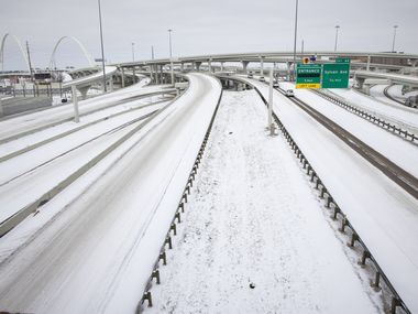 Snow covers I-30 and I-35E close to Downtown Dallas on Monday.