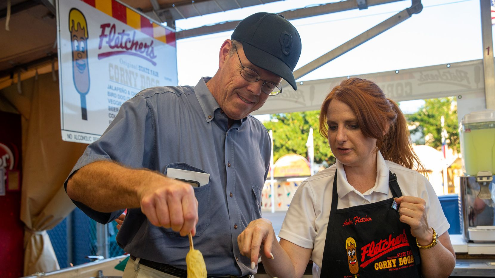 Amber Fletcher (right) teaches The Dallas Morning News subscriber Sam Taylor how to fry a Fletcher's corny dog during a TDMN members event at Fair Park in Dallas on Thursday, Sep. 26, 2019. (Lynda M. Gonzalez/The Dallas Morning News)