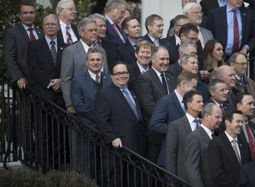 Rep. Blake Farenthold, R-Texas, (center, holding on to the railing) stands with other members of congress before President Donald Trump arrives to speak during an event on the South Lawn of the White House in Washington, Wednesday, Dec. 20, 2017, to acknowledge the final passage of tax cut legislation by congress.