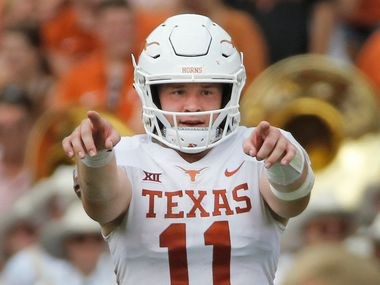 FILE - Texas quarterback Sam Ehlinger (11) is pictured during the annual Red River Showdown against Oklahoma at the Cotton Bowl in Dallas on Saturday, Oct. 6, 2018.