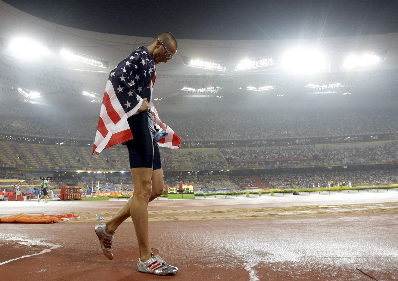 2008 Beijing Olympics: Silver medalist Jeremy Wariner walks around the National Stadium after LaShawn Merritt won gold in the Men's 400 meter final at the National Stadium  in Beijing, China Thursday August 21, 2008.