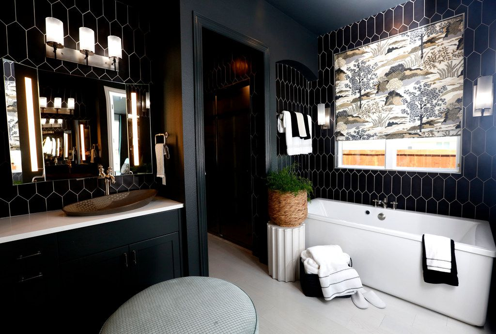 Black walls in a bathroom? It works, says the designer Tiffany Brooks.