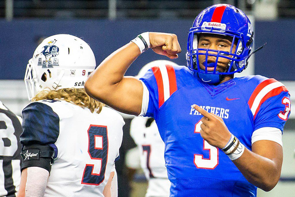 Duncanville quarterback Ja'quinden Jackson flexes after running 40 yards for a go-ahead touchdown in the fourth quarter of a 44-35 win over Allen in a Class 6A Division I state semifinal on Dec. 15, 2018 at AT&T Stadium. (Smiley N. Pool/The Dallas Morning News)