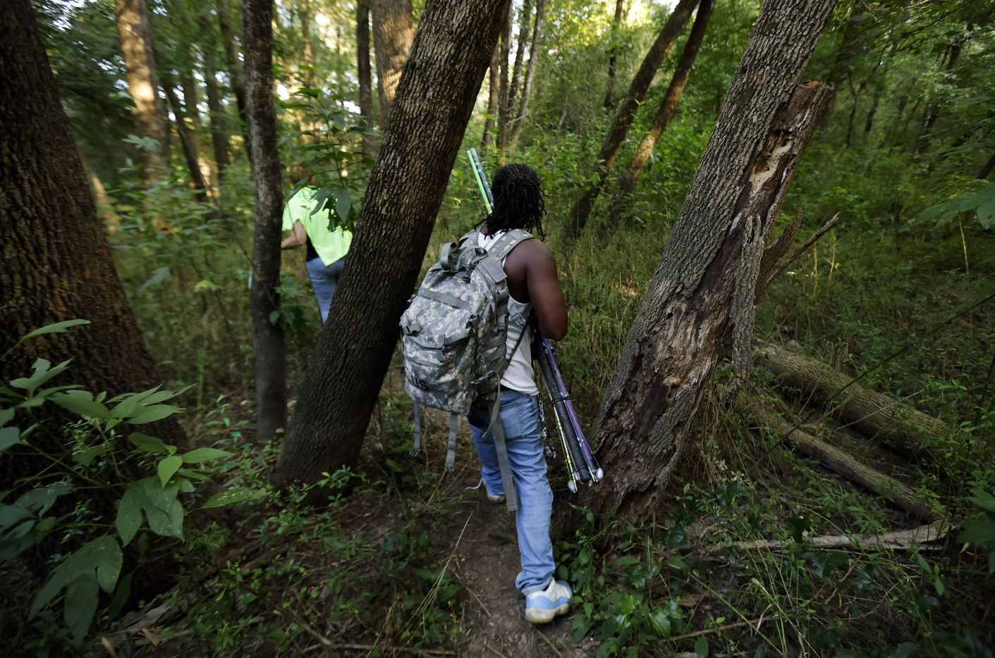 Odell Allen hikes through the Great Trinity Forest to a favorite alligator gar fishing spot along the Trinity River in Dallas, Wednesday, September 1, 2021. (Tom Fox/The Dallas Morning News)