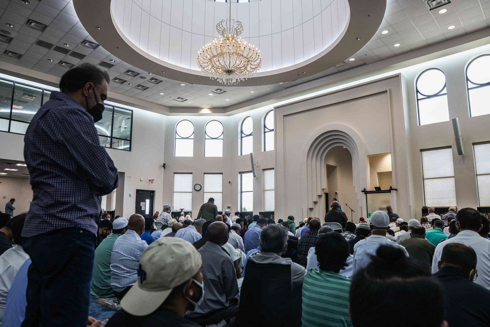 Dozens of Muslim men listened to a lecture in the main prayer hall of the East Plano Islamic Center before their afternoon prayers on Aug. 27, 2021.