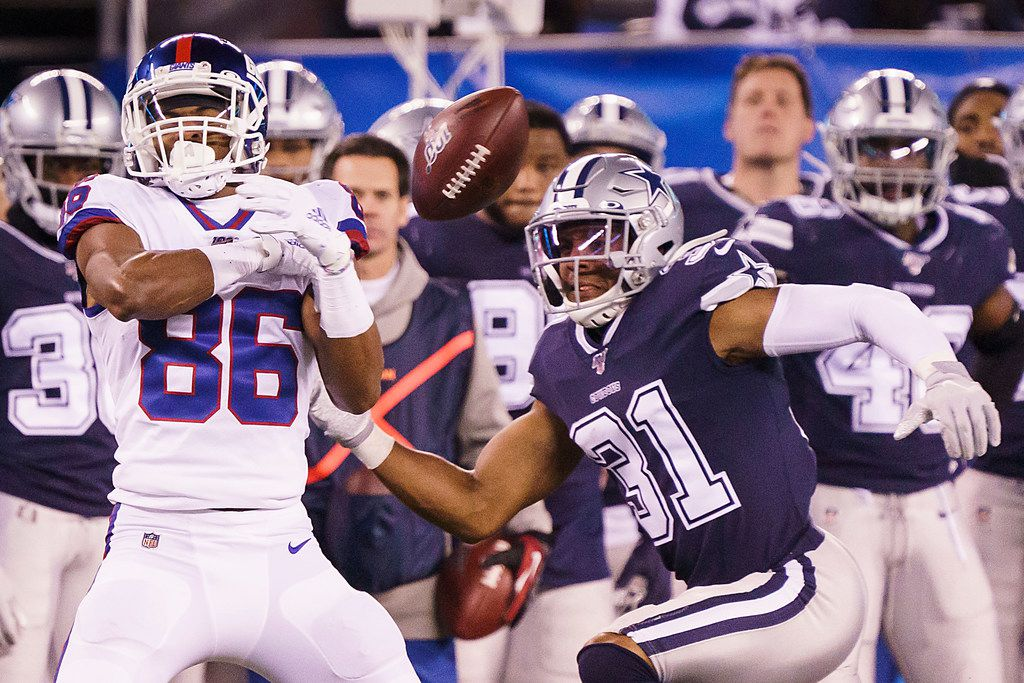 A pass goes off the hands of New York Giants wide receiver Darius Slayton (86) as Dallas Cowboys cornerback Byron Jones (31) defends during the first half of an NFL football game, Monday, Nov. 4, 2019, in East Rutherford, N.J.