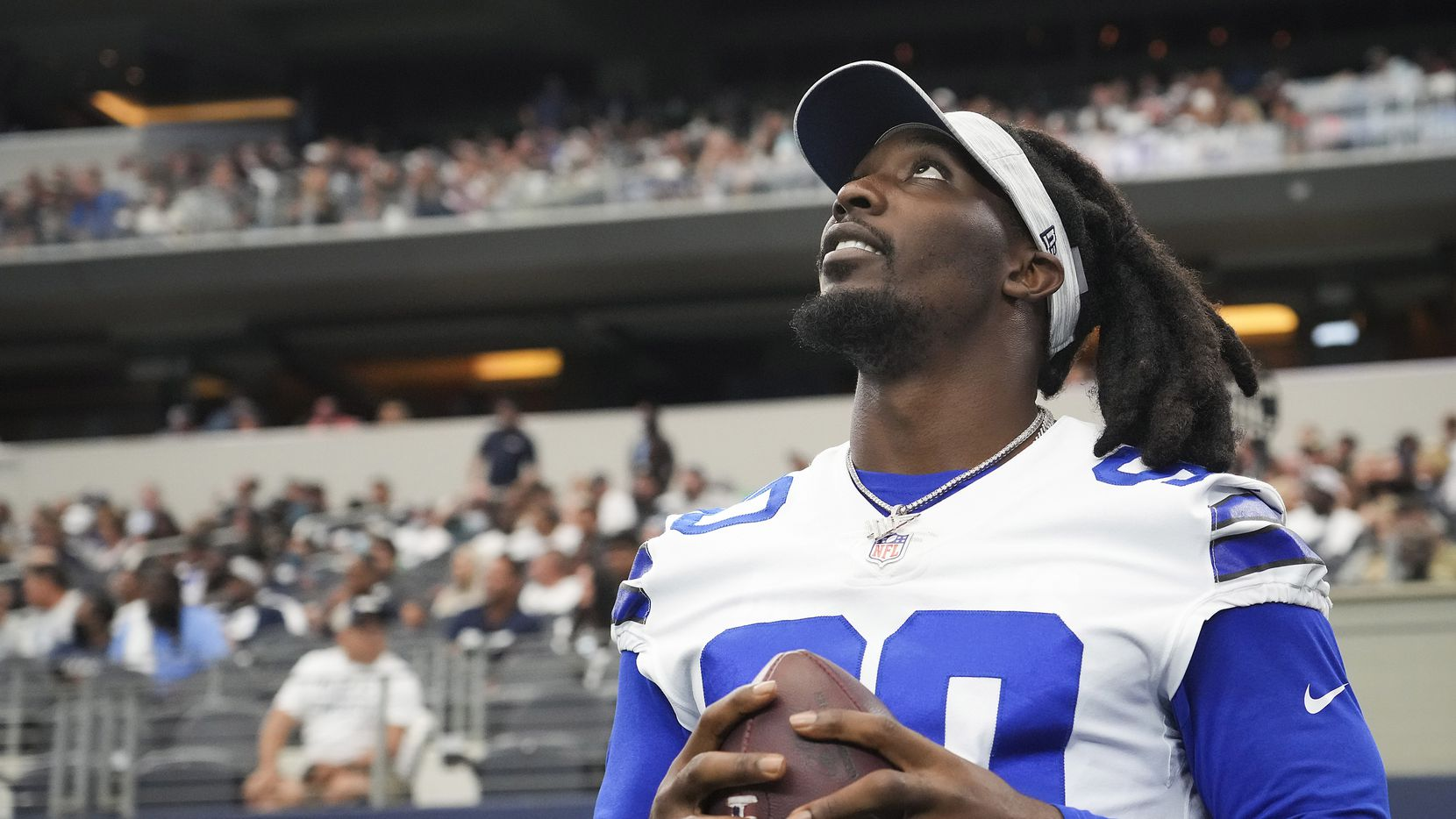 Dallas Cowboys defensive end DeMarcus Lawrence watches from the sidelines during the second half of a preseason NFL football game against the Jacksonville Jaguars at AT&T Stadium on Sunday, Aug. 29, 2021, in Arlington.