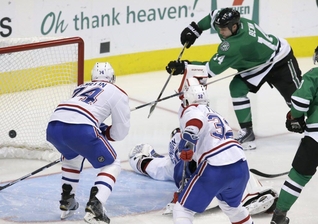 Dallas Stars left wing Jamie Benn (14) scores a goal against Montreal Canadiens goalie Dustin Tokarski (35), Alexei Emelin (74) and Brian Flynn (32) during the third period of an NHL hockey game Saturday, Dec. 19, 2015, in Dallas. The Stars won 6-2. (AP Photo/LM Otero)