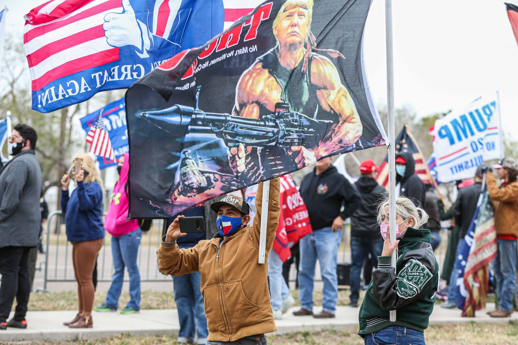 President Donald Trump supporters at S 10th St and Bales Rd during a rally as Trump is scheduled to visit part of the wall built under his mandate in McAllen on Tuesday, January 12, 2021.