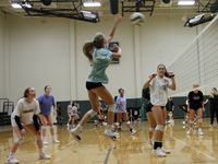 Kennedale's Grayson Reed skies to fire a shot as she is flanked by teammates Tatum Pavey (left) and Bryley Steinhilber (right) during the team's first fall practice of the season Monday. (Steve Hamm/ Special Contributor)